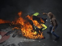 Demonstrators burn uniforms as clashes broke out while the Constituent Assembly election was being carried out in Caracas