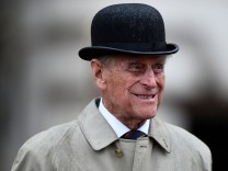 Britain's Prince Philip, in his role as Captain General, Royal Marines, attends a Parade to mark the finale of the 1664 Global Challenge, on the Buckingham Palace Forecourt, in central London
