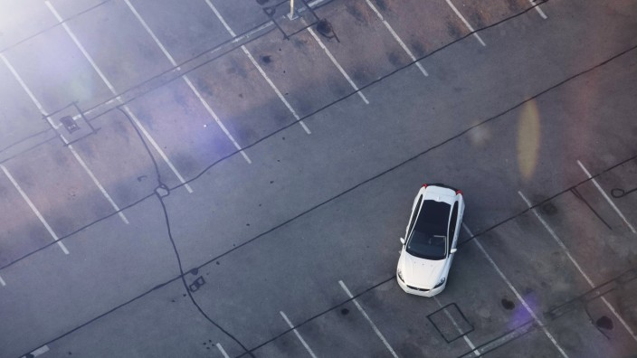 Electric car on parking lot drone photography Electric car on parking lot drone photography MMAF00