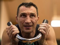 FILE PHOTO: Ukrainian heavy weight boxing World Champion Wladimir Klitschko attends a public training session in Going