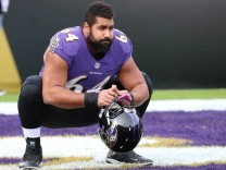Baltimore Ravens guard John Urschel warms up prior to the game against the Miami Dolphins at M&T Bank Stadium in Baltimore