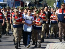 A picture taken on July 13 2017 in Mugla shows Turkish gendarmes escorting a former army special f