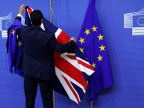 FILE PHOTO: Flags are arranged at the EU Commission headquarters ahead of a first full round of talks on Brexit, Britain's divorce terms from the European Union, in Brussels