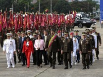 Venezuela's President Nicolas Maduro arrives for a military parade to celebrate the 80th anniversary of the Venezuela's National Guard, in Caracas