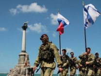Russian servicemen take part in the Navy Day celebrations in the Black Sea port of Sevastopol