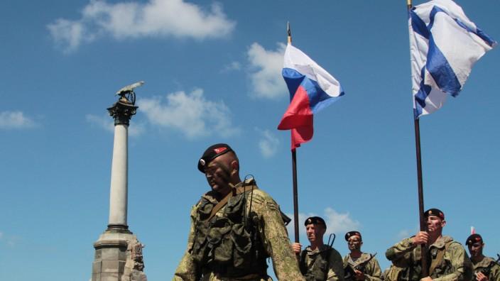 Russian servicemen take part in the Navy Day celebrations in the Black Sea port of Sevastopol