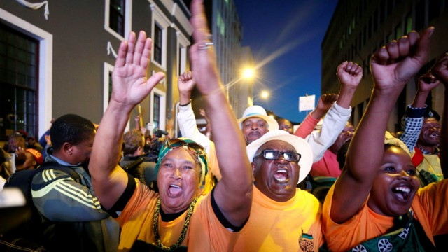 Pro-Zuma supporters celebrate after the vote of no confidence against President Jacob Zuma failed in Cape Town, South Africa