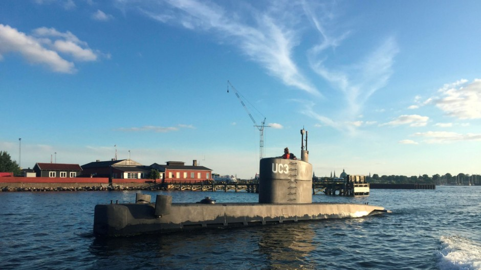 An unidentified woman stands in the tower of the private submarine 'UC3 Nautilus' pictured in Copenhagen Harbor