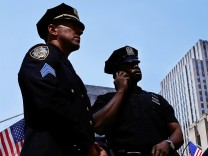 New York Police Department officers stand on 5th Avenue in New York