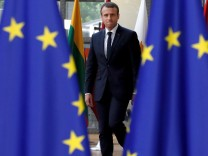 French President Emmanuel Macron arrives at the EU summit in Brussels