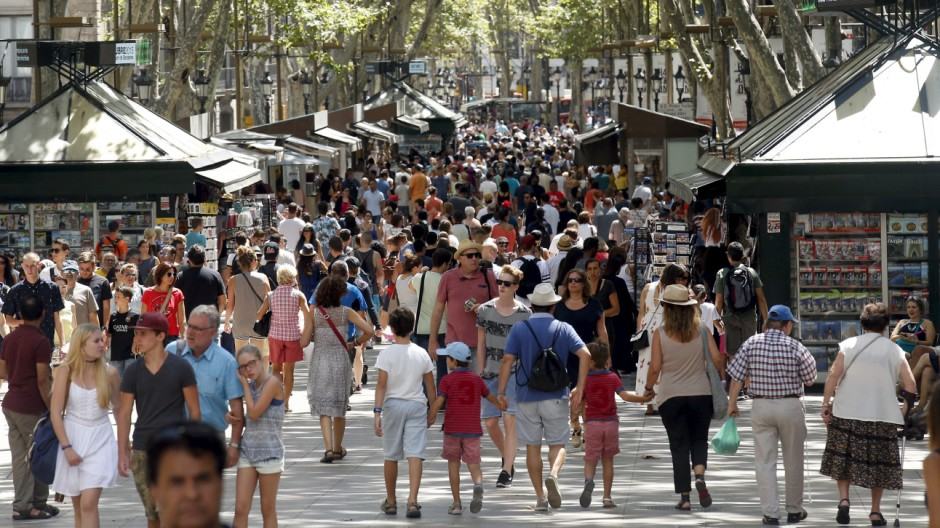 People walk by Las Ramblas in Barcelona