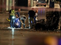 Forensic police officers search for clues near the area where a van crashed into pedestrians at Las Ramblas in Barcelona