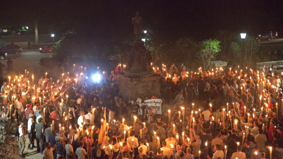 White nationalists carry torches on the grounds of the University of Virginia, on the eve of a planned Unite The Right rally in Charlottesville