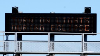 A sign on the highway refers to the upcoming solar eclipse near Guernsey