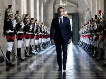 French President Emmanuel Macron  walks through the Galerie des Bustes (Busts Gallery) to access the Versailles Palace's hemicycle for a special congress gathering both houses of parliament near Paris