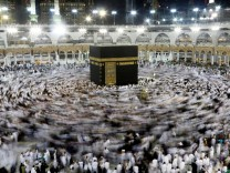 Muslims gather around the Kaaba inside the Grand Mosque during the holy fasting month of Ramadan in Mecca