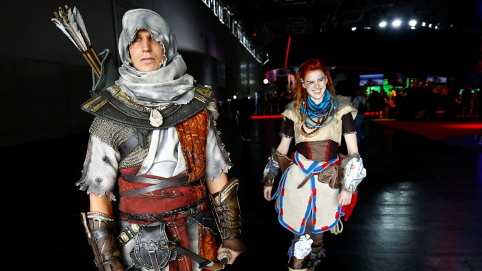 People dressed up as video game characters attend the world's largest computer games fair Gamescom in Cologne