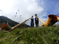Alphorn blowers perform an ensemble piece on the last day of the International Alphorn Festival on Lac de Tracouet near the village of Nendaz