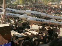 India's Brahmos supersonic cruise missiles pass by during a full dress rehearsal for the Republic Day parade in New Delhi