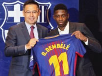 Dembele gestures during his official presentation at the Camp Nou