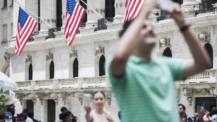 Activities outside the New York Stock Exchange Tourists and workers outside he New York Stock Exchan