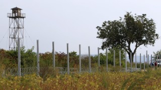 A fence erected by Hungarian soldiers is seen on the border with Croatia near Sarok