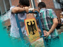 Asylum seekers wait in front of the Federal Office for Migration and Refugees (BAMF) at Berlin's Spandau district; Democracy Lab Leipzig