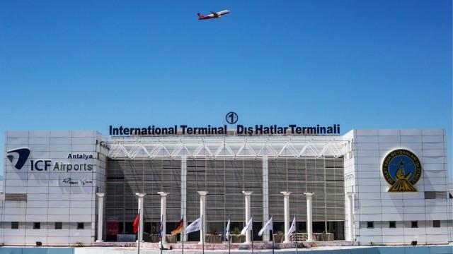 ANTALYA TURKEY AUGUST 26 2017 A plane flies over the Antalya International Airport Sergei Boby