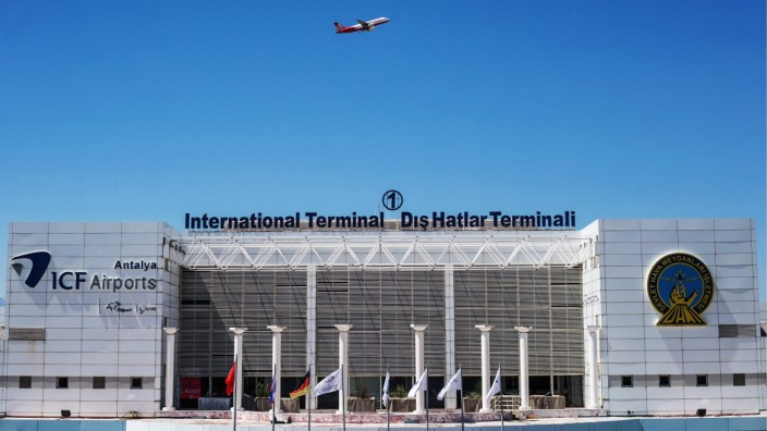 ANTALYA TURKEY AUGUST 26 2017 A plane flies over the Antalya International Airport Sergei Boby