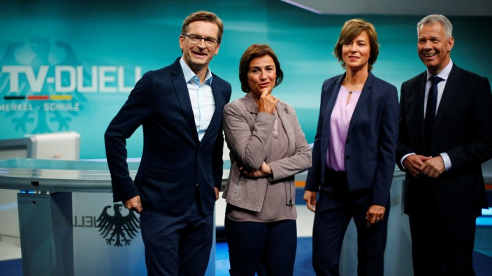 TV presenters pose at the Adlershof TV studio to present the only TV debate of the German election between incumbent German Chancellor Angela Merkel and SPD candidate Martin Schulz