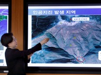 South Korea's Earthquake and Volcano Monitoring Division officer points at where seismic waves observed during a media briefing at Korea Meteorological Administration in Seoul