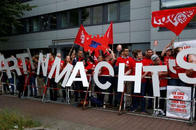Supporters of Germany's SPD candidate for chancellor Schulz react in Berlin
