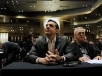 Greek Prime Minister Alexis Tsipras sits next to Deputy Prime Minister Giannis Dragasakis (R) before his speech at the ruling Syriza party central committee in Athens, Greece