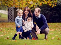 Handout photo of Britain's Prince William and his family; Handout photo of Britain's Prince William and his family