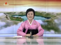 FILE PHOTO: A North Korean KRT TV presenter announces the successful launch of  a new intercontinental ballistic missile
