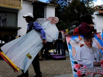 Man carries an image of Pope Francisco near Bolivar square in Bogota