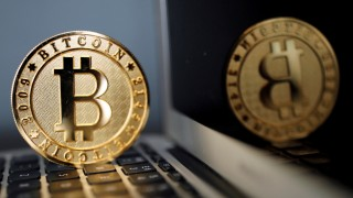 FILE PHOTO: A Bitcoin (virtual currency) coin is seen in an illustration picture taken at La Maison du Bitcoin in Paris