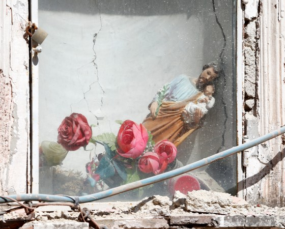 A religious statue slumps to the side after an earthquake hit the island of Ischia