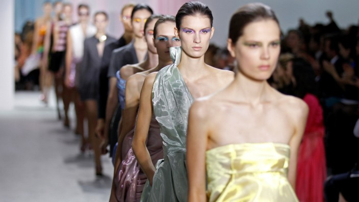 FILE PHOTO: Models present creations by Belgian designer Raf Simons as part of his Spring/Summer 2013 women's ready-to-wear fashion show for French house Dior during Paris fashion week