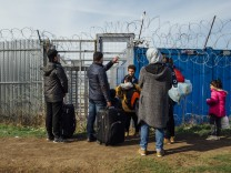 March 23 2017 Kelebija Serbia Syrian refugee family at the Kelebija transit camp just before c