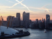 FILE PHOTO: Canary Wharf and the City at sunset in London