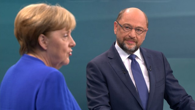A screen that shows the TV debate between German Chancellor Angela Merkel of the Christian Democratic Union (CDU) and her challenger Germany's Social Democratic Party SPD candidate for chancellor Martin Schulz in Berlin