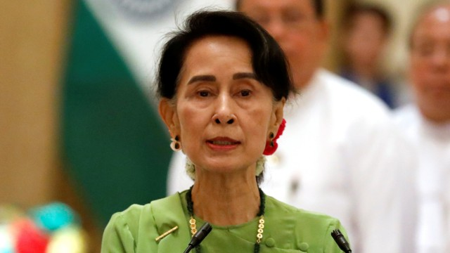 Myanmar State Counselor Aung San Suu Kyi talks during a news conference with India's Prime Minister Narendra Modi in Naypyitaw