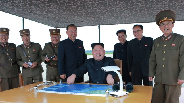 North Korean leader Kim Jong Un inspects a long and medium-range ballistic rocket launch drill