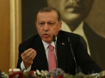Turkish President Tayyip Erdogan speaks during a news conference at Ataturk International Airport in Istanbul