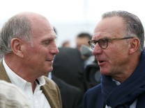 Former Bayern Munich President Hoeness speaks to Rummenigge, CEO of Bayern Munich during official foundation stone laying ceremony of Bayern Munich's youth training centre in Munich
