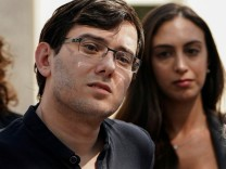 FILE PHOTO: Former drug company executive Martin Shkreli stands with his attorney Benjamin Brafman after exiting U.S. District Court in the Brooklyn borough of New York City