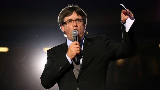 Catalan regional President Carles Puigdemont speaks during a Catalan pro-independence meeting at Tarraco Arena in Tarragona