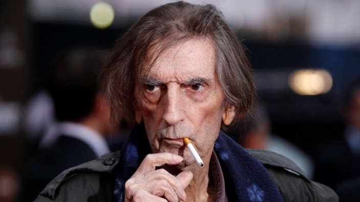 FILE PHOTO: Actor Stanton smokes a cigarette as he poses at the world premiere of the film 'Marvel's The Avengers' in Hollywood, California