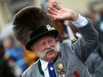A man dressed in traditional Bavarian clothes takes part in the Oktoberfest parade in Munich